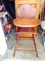 High chair. Wooden antique in Glendale Heights, Illinois