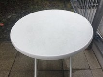 Round lawn table in a good shape in Ramstein, Germany
