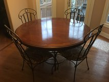 Iron table with cherry wood top and 4 chairs in Schaumburg, Illinois
