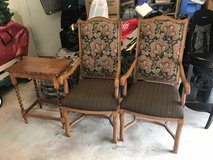 Pair of antique wooden chairs and table in Colorado Springs, Colorado