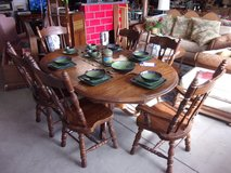 Cannonball Table With Lion Feet and Six Chairs Set in Fort Riley, Kansas