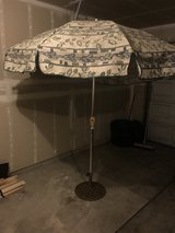 Tilting Patio Umbrella with cast iron stand in Olympia, Washington