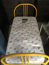Metal toddler bed and mattress in Fort Leonard Wood, Missouri