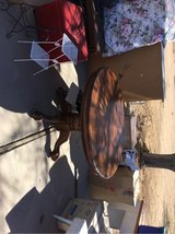 Very good condition/oak kitchen table w/ leaf that extends table and large claw feet. in 29 Palms, California