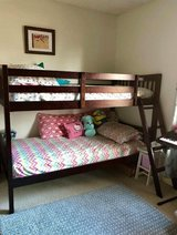 Twin size bunk bed with mattresses and bed sheets in Clarksville, Tennessee