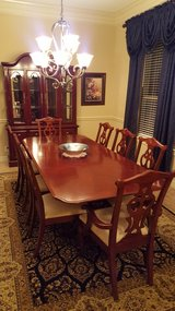 Cherry finish, solid wood dining room table and 8 matching chairs. in Fort Sam Houston, Texas