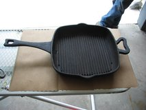 "Paula Deen 11"" cast iron griddle with raised bars sits flat in Schaumburg, Illinois"
