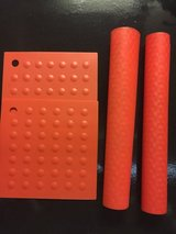 Red silicone baking mats and pot holders in Eglin AFB, Florida