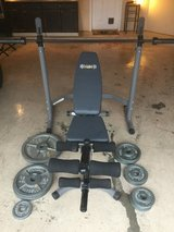 Adjustable weight bench with leg press and 255 lbs of weights in Conroe, Texas
