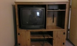 solid wood Entertainment center with free tv in Fort Leonard Wood, Missouri