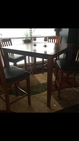 Height top table set leather in a great condition  for $350 or obo in Lawton, Oklahoma