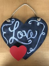 "Chalkboard ""love"" heart shaped sign in Perry, Georgia"