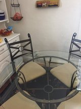 Glass top kitchen table w/4 chairs in Sandwich, Illinois