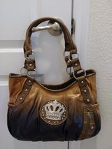 One New purse in Conroe, Texas