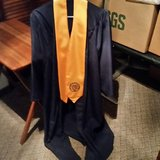 Uco graduating cap and gown for Bachelors, worn once. in Tinker AFB, Oklahoma
