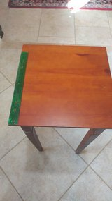 Square brown wooden table in Spring, Texas