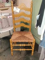 Old wooden and wicker seat chair in Liberty, Texas