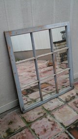 Hanging window frame mirror in Lackland AFB, Texas