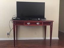 Red and black wood table in Beaufort, South Carolina