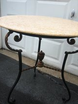 round marble  and iron decorative table in St. Charles, Illinois