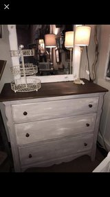 Repurposed distresses gray dresser. Top surface sanded and revarnished in Chicago, Illinois