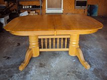 Solid wood table with two leaves in Orland Park, Illinois
