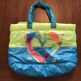 Justice neon heart zip tote bag in Perry, Georgia