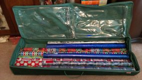 Rubbermaid wrapping paper carrier w/ paper in Perry, Georgia