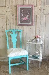 Chair and small tier table in Kingwood, Texas