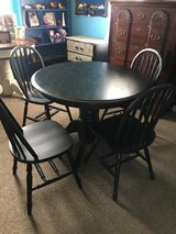 "All wood table and 4 chairs 42""round 29"" tall in Kingwood, Texas"
