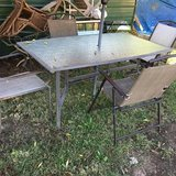"Large patio table 4 chairs umbrella 66x40"" 26"" tall in Fort Riley, Kansas"