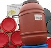 50 GAL PLASTIC BARRELS RED AND BLACK SCREW ON LIDS in Tacoma, Washington