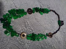 Green wooden necklace set in Fort Lewis, Washington