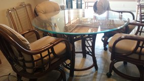 Rattan table with glass top in Elizabethtown, Kentucky