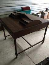 Antique walnut double sided hotel desk in Shorewood, Illinois