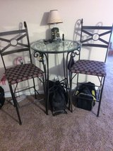 Pedestal Table with two bar stool chairs in Pleasant View, Tennessee