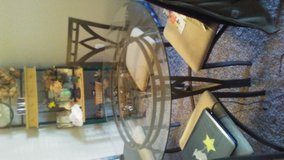 Glass table and 4 matching chairs in Clarksville, Tennessee