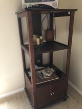 Upright entertainment stand in Kingwood, Texas