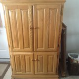 Computer armoire with chair in Fort Drum, New York