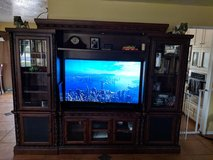 Beautiful dark wood entertainment center, North Shore by Ashley in Fort Irwin, California
