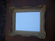 Mirror with golden wooden frame in Ramstein, Germany
