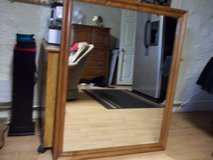 solid oak trimmed mirror off dresser. - very heavy- very nice in 29 Palms, California