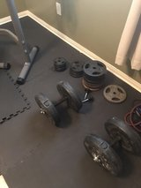 free weights, bench, weights and foam flooring in Kingwood, Texas
