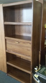 Tall bookcase with desk in Naperville, Illinois