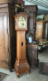 Beautiful Dutch grandfather clock with bronze figurines on top in Ansbach, Germany