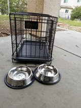 small dog kennel with bowls in Vista, California
