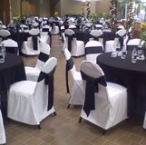 White fabric chair covers with black sashes in Glendale Heights, Illinois