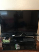 "Sharp 70"" tv and stand in Kingwood, Texas"