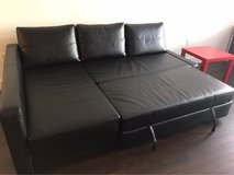 black leather bed sofa + red table in Huntington Beach, California