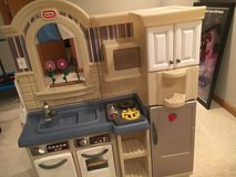 Little Tykes double sided play kitchen with cart and accessories in Glendale Heights, Illinois
